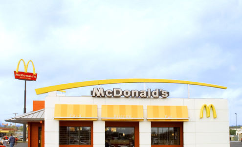 McDonald's staff in line for recycled uniforms