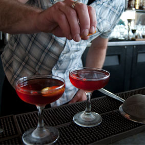 Budgeting drinkers lift spirits with luxury brands