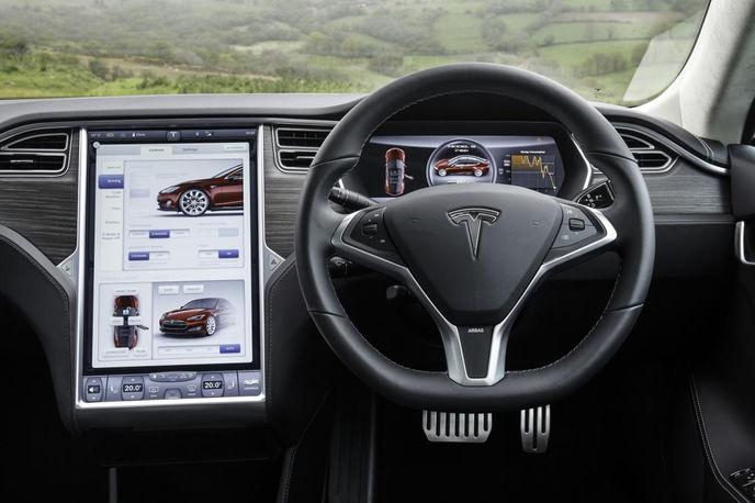 The Tesla S Model software uses a combination of sonar, cameras and a dozen ultrasonic sensors