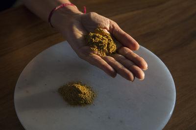 Turmeric in Kavita Khosa's hand